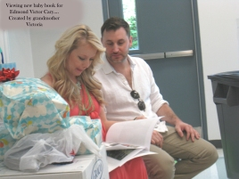 Ashley and Doug viewing Edmond Victors baby book 5-21-16