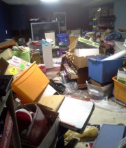 massive-hoarder-mound-in-basement-main-room
